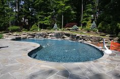 waterfall swimming pool,water feature swimming pool, water feature,back yard landscaping,exotic swimming pool, artistic swimming pool,man made water feature, man made waterfalls
