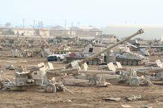 A scrapyard at Camp Taji (or Camp Cooke), Iraq