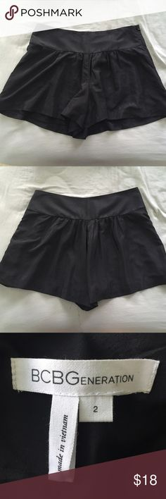BCBGeneration Black Shorts Black flowy shorts. Big pockets in front and super comfortable! Size 2 by BCBGeneration. First picture shows front, second shows back. Zipper on left side. BCBGeneration Shorts