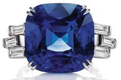 Sunset by Harry Winston, Sapphire and Diamond Ring.     Cushion-cut sapphire, 18.51 carats; 6 baguette diamonds, 1.25 total carats; platinum setting.
