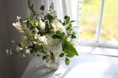 Verdant table setting; white and green. By Amy Merrick, via Flickr