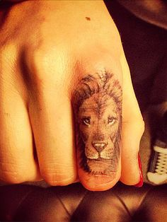 Lion finger tattoo - ugh, i've been wanting to get this for a while now.. Dont want to get the Same thing though