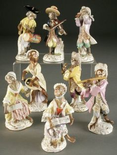 8 PIECE COMPOSITE MEISSEN PORCELAIN MONKEY BAND 19th century after the models by Kaendler comprised of two singers, violinist, drummer, flutist, guitar player, horn player and bell ringer. Some minor loss and restoration. Blue crossed swords mostly with pommels.