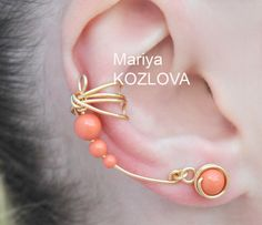 Coral Wings - gold craft wire, Swarovski crystal pearls. $15.65, via Etsy.