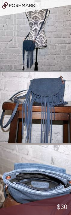 Free People Fringe Cross Body Bag Blue Free People adjustable cross body purse! Light weight purse with two small interior pockets. The purse has a zip close under the fringe flap. Please look at all photos before purchasing!   Thank you :) Free People Bags Crossbody Bags