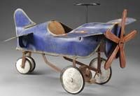 "Has 4 wheels, technically it is a pedal powered ""car"" with wings that flies."