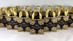 Elegant Black & Gold wedding welcome bags with satin ribbon handles and your names. Chic mehendi design. personalized Indian wedding gifts and favors for guests. #personalizedgifts #giftbags #weddingfavor #weddingwelcomebags #welcomebags #weddingfavorideas #weddingparty #weddingfavorideas #weddingparty #weddingfavour #weddingwelcome #indianwedding #elegantwedding #goldwedding #weddingbag #blackandgold #mehendi