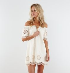 We've always been inspired by vintage style and fabrication. This off-shoulder dress is made from delicate lace & embroidered cotton, inspired by the dreamcatcher symbol. Effortless and easy fit, the off-shoulder detail is pulled together by handmade tassels.  Made from 100% lightweight natural cotton+lined. Fitting & Sizing: Our model Georgia is 5'9 (1.75cm), wearing size S....  Read more