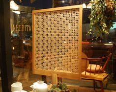 Sidecar Furniture's  cane screen woven in the daisy pattern