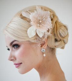 This gorgeous updo, and fascinator instead of veil, and I love the darker smoky eye - great with my dark features!