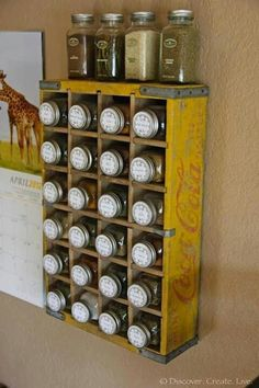 Great idea to use an old wooden Coca Cola divided crate as a spice rack.