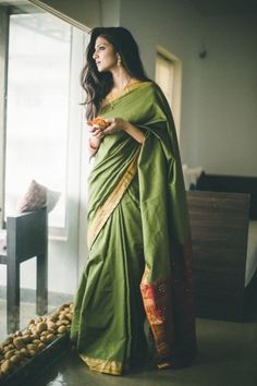 Green cotton saree with gold border and mirror work on pallu