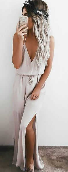 Expect some fan mail after you spend a day in the Crush and Croon Light Taupe Embroidered Maxi Dress! Embroidery decorates a darted, triangle bodice with an array of back straps. Loose silhouette is cinched by a tasseled waist sash above a woven maxi skirt with twin side slits. #lovelulus