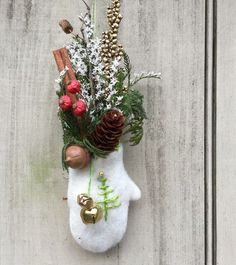 Embroidered Christmas felt mitten ornament filled with fragrant cinnamon, pine and berries.