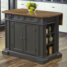 With its deep grey painted base and distressed oak finished top, the Home Styles Americana Kitchen Island with Stools adds style and function to your eating area. The island offers plenty of storage while 2 matching stools are contoured for comfort. Drop Leaf Kitchen Island, Kitchen Island With Seating, Kitchen Islands, Blue Kitchen Island, Boho Kitchen, New Kitchen, Kitchen Decor, Kitchen Ideas, Kitchen Stools