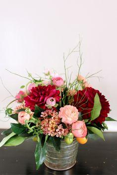Fun size arrangement of dahlias, ranunculus, kumquat and wax flower