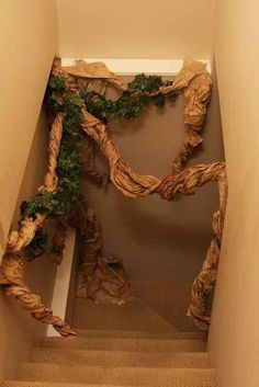 Make a devil's snare with brown packing paper and fake vines from the craft…
