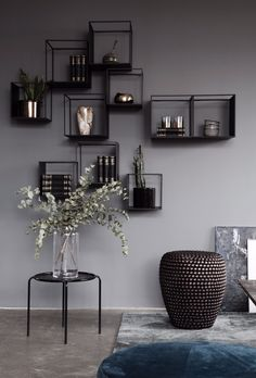 Shelving display. Pols potten stool and dark background. Designed by S i D