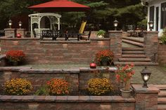 Stone walls give definition, privacy and support to your yard and patio design and add to the beauty of your property. Choose from textured concrete, natural stone or brick to complement your landscape design.