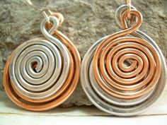 Copper and SIlver Earrings Unique Earrings Funky Earrings Mismatch Earrings Opposite Earrings Mixed Metal Spiral Earrings Clip On Available. $15.67, via Etsy.
