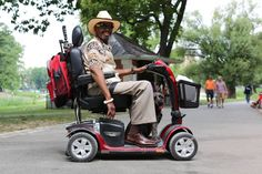 """This man was cruising through Central Park, while his dog jogged out in front of him. """"They keep trying to give us tickets,"""" said the man, """"So I taught him a trick. Watch this.""""  He shouted: """"Police!""""  And the dog jumped up on the scooter. Humans of New York"""