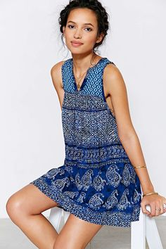 """Ecote Gauze True Blue Frock Dress Product Sku: 34273318; Color Code: 049 Paisley-printed frock dress from boho brand Ecote. Lightweight + breezy construction cut short featuring a banded waist, colorblock prints and a banded v-slit at the rounded neckline. Content + Care - Rayon - Machine wash - Imported Size + Fit - Model is wearing a Medium - Measurements taken from size Medium - Chest: 23"""" - Length: 34"""""""