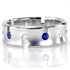 This alluring take on an eternity band features alternating rich blue sapphires and white diamonds. http://www.knoxjewelers.biz/products/design-2483