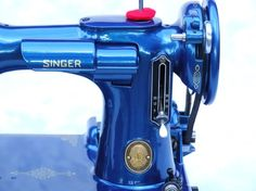 "blue Singer ""221 Featherweight"" sewing machine"
