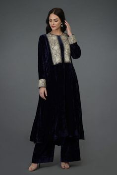 """From """" NOOR"""", our new collection of Kashmiri tilla embroidery adorned silk velvets, this midnight blue silk velvet kurta is adorned with silver Tilla embroidery. The midnight blue silk velvet kalidaar asymmetrical Velvet Pakistani Dress, Simple Pakistani Dresses, Pakistani Bridal Dresses, Pakistani Dress Design, Pakistani Outfits, Indian Outfits, Velvet Suit Design, Velvet Dress Designs, Dress Neck Designs"""