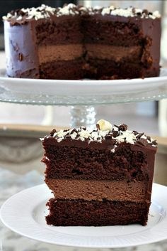 This Chocolate Cheesecake Cake recipe is a decadent Chocolate Cake with a layer chocolate cheesecake in the middle. A how to video is included. Cheesecake Cake, Cheesecake Recipes, Dessert Recipes, Chocolate Cheesecake Cupcakes, Yummy Recipes, Recipies, Decadent Chocolate Cake, Chocolate Desert Recipes, Chocolate Cream Cheese Cake