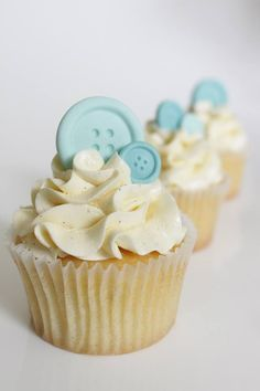Button Cupcakes  Made for a Baby Shower these delicious vanilla bean cupcakes with swiss meringue buttercream are finished off with cute fondant buttons.  Made by Yum ME Cakes, Sydney. https://www.facebook.com/yummecakesbymareandemma