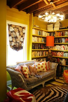 Love the yellow walls and all the books.