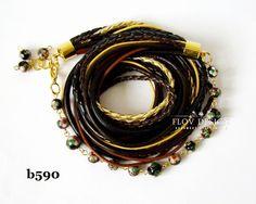 flov design: Bracelet and earring in black, brown and gold...