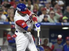 Yadier Molina #4 of Puerto Rico hits a solo home run during the sixth inning of the World Baseball Classic Pool F Game One between the Dominican Republic and Puerto Rico at PETCO Park on March 14, 2017 in San Diego, California.