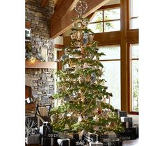 Woodland Christmas tree with peace sign tree topper. Potterybarn.com
