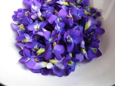 I used to pick bouquets of violets like this for my mother on the way home from school. They grew under a large bush in an empty lot. Mother loved them-- and so do I!