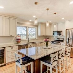 Titus Contracting completed a beautiful, bright, open concept kitchen near Lake Nokomis. It's the perfect space for our client's to entertain their family and friends. #kitchen #remodel #openconcept
