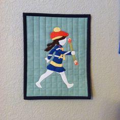 The baton twirler mini applique quilt by Allison Rosen