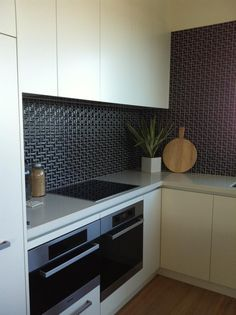 Black L-Mosaic tiles for a kitchen splashback