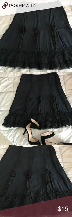 Black silk skirt with pleated ruffle bottom Sz 12 Stunning skirt has never been worn, has beautiful double pleated ruffle at bottom and ribbon detail up skirt . Hidden side zip keeps it clean, all you need is a simple top and heels to make a gorgeous outfit Anne Carson Skirts A-Line or Full