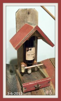 Recycled wine bottle/barn wood..handcrafted into a bird-feeder