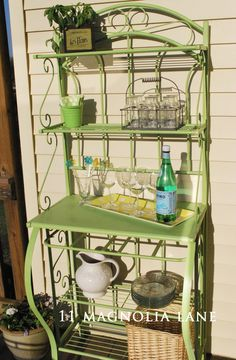 Do you have an old baker's rack that you just can't give away?  Spray paint it a cheerful color and repurpose it outside as a bar or buffet--perfect for entertaining!