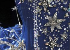 Detail of Kylie's showgirl costume - get your glue gun ready.