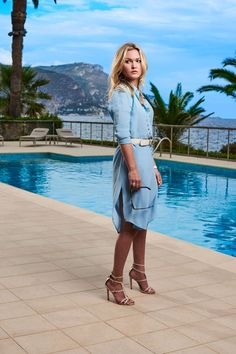 Georgina is the Queen of daytime summer dressing. Her wardrobe includes a multitude of excellent lightweight dresses, including this blue design.