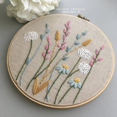 Floral Embroidery Hoop Art by And Other Adventures Embroidery Co A field of flowers that will never fade away. This freehand embroidery is hand-stitched on to oatmeal colored linen and featured in a embroidery hoop. Hand Embroidery Projects, Floral Embroidery Patterns, Embroidery Flowers Pattern, Hand Embroidery Stitches, Crewel Embroidery, Embroidery Hoop Art, Hand Embroidery Designs, Vintage Embroidery, Machine Embroidery