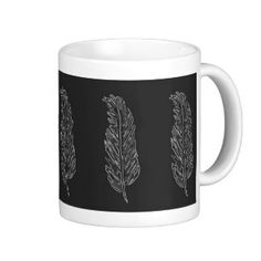 Mug with white feathers on solid black background mug