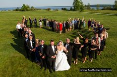 Unique group Wedding photo outdoor lawn mission point resort at mission point resort mackinac island by http://www.paulretherford.com