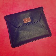 """MICHAEL KORS iPad black envelope 10.5"""" x 8.5"""" new with tags and original box stylish MICHAEL KORS iPad black pvc envelope with gold signature plate. I bought for my iPad but never used because I gave my iPad away to my son  Michael Kors Bags"""