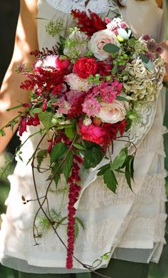 Rustic and wild shower bouquet with trails. Deep and pale pinks, garden Roses and Amaranths, designed and created by www.hannahberryflowers.co.uk based in Farnham, Surrey. Photo by Louise http://thelittleredrobin.blogspot.co.uk