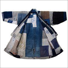 ItemIndigo Cotton Boro Jacket Boro patched & patched again. Some sashiko stitching. Age Early 1900s